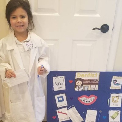 A young patient dressed as a dentist.