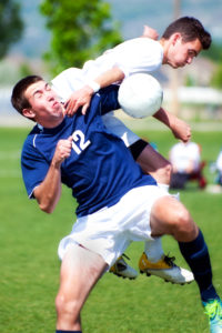 soccer player hit with ball